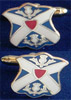 Enamelled Cufflinks of the Society's arms.